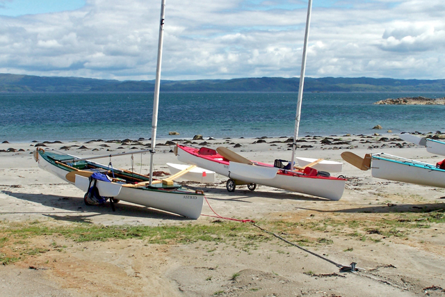 sailing canoes on a beach on Mull