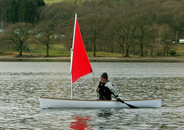 Solo paddling canoe with small lugsail